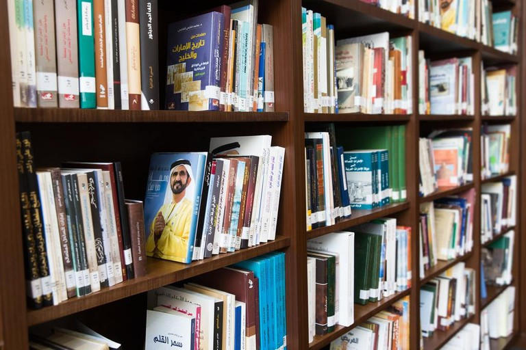Shelves stacked with Arabic books