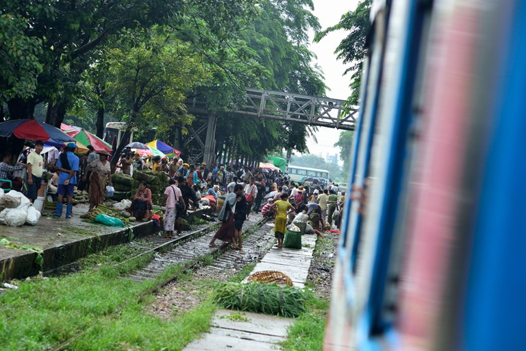 Da Nyin Gone Market spilling over train tracks near Yangon, Myanmar