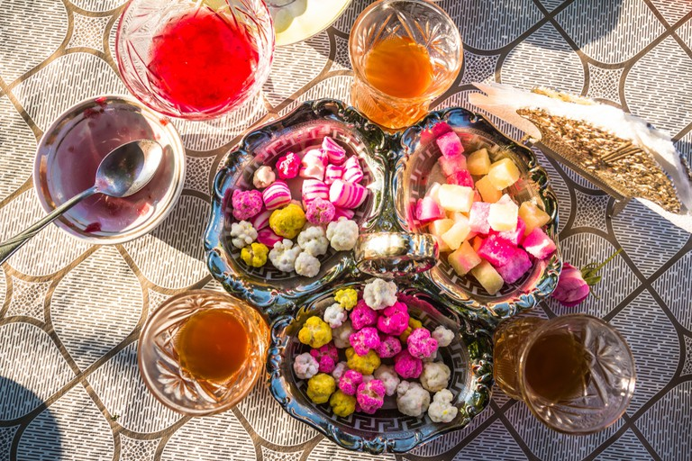 Guests are often served endless tea with sweets