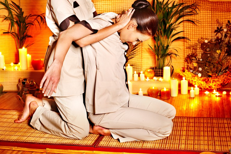 Stretches during a Thai massage