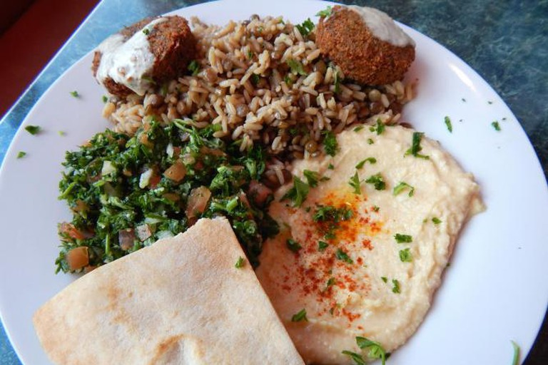 Med Cuisine's veggie platter with hummus, tabouleh, falafel, pita, and rice.