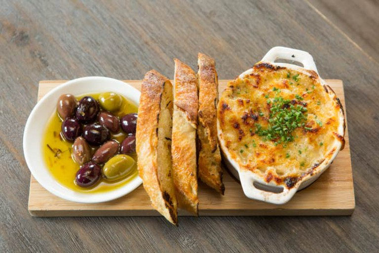 Wild mushroom fondue, grilled bread and house marinated olives