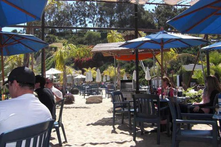 View of the outdoor, beachfront seating at Paradise Cove Beach Café
