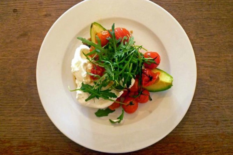 A Little Bit Of What You Fancy, Poached Eggs with Vine Ripe Tomatoes, Avocado, Rocket and Chilli Jam on Sourdough Toast
