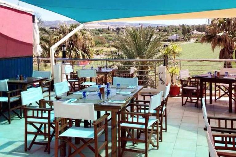 The beautiful outdoor dining area of Aqui Mediterranean Fusion Restaurant
