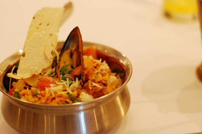 Hyderabadi specialty of slow cooked basmati rice with mixed seafood, served with cucumber raita