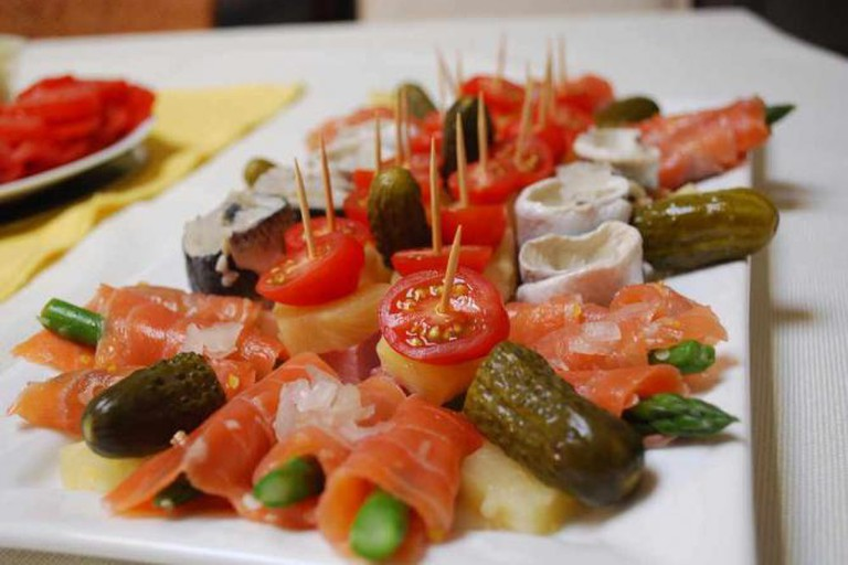 Traditional Russian specialities such as pickled gherkins, herring, and smoked salmon