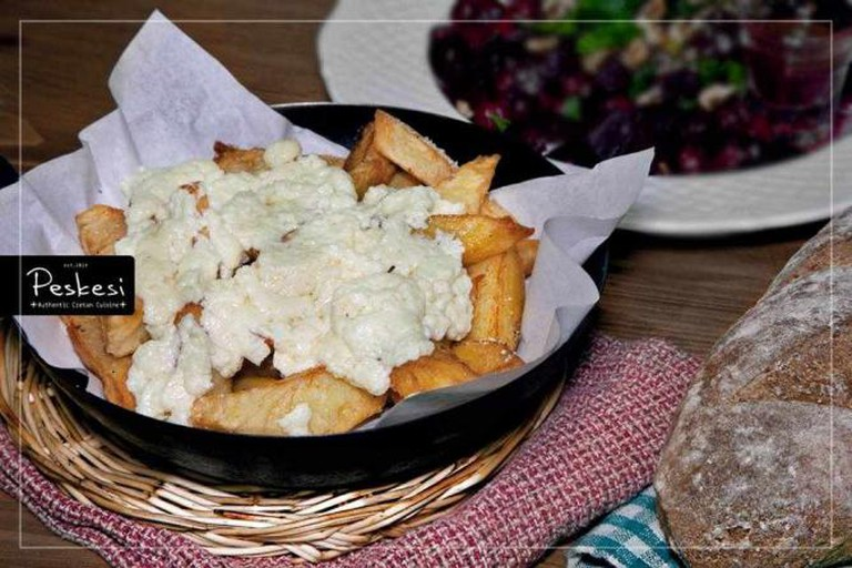 Cretan staka cheese on French fries
