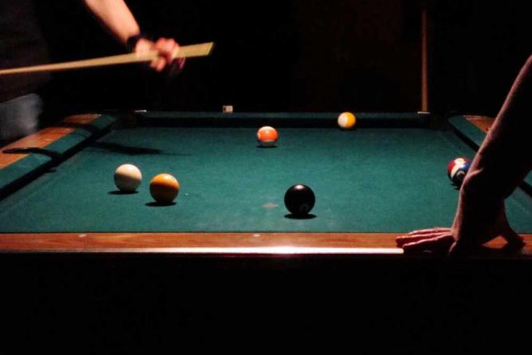 Play pool at Patron's