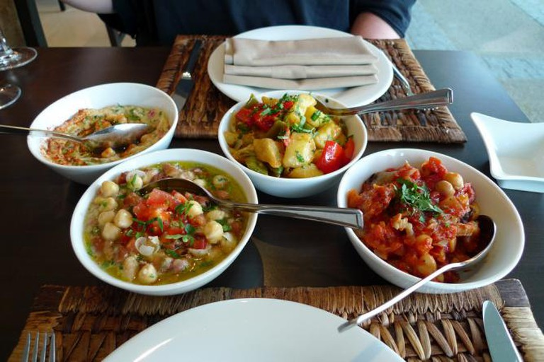 Lebanese mezze (from left: hummus , foul moudamas, batata harra and moussaka)