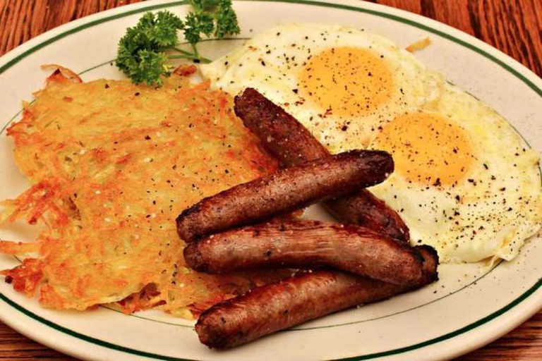 Breakfast - hash browns fried in olive oil, butter basted eggs, sausage links