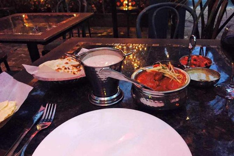 Plate setting at Ambrosia India Bistro