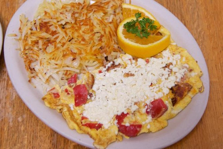 Linguica omelette with feta cheese and roasted red peppers