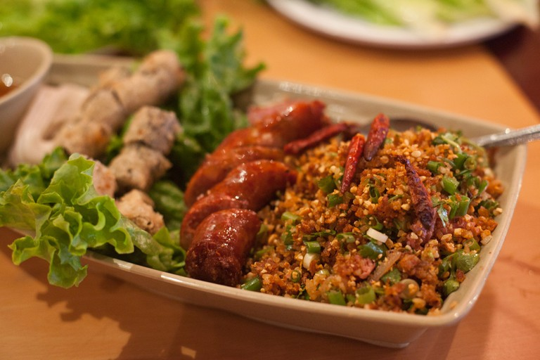 Lao sausages with rice salad and spring rolls