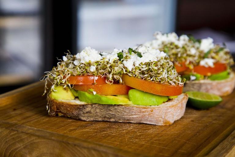 Avocado, tomato, watercress and feta on toast