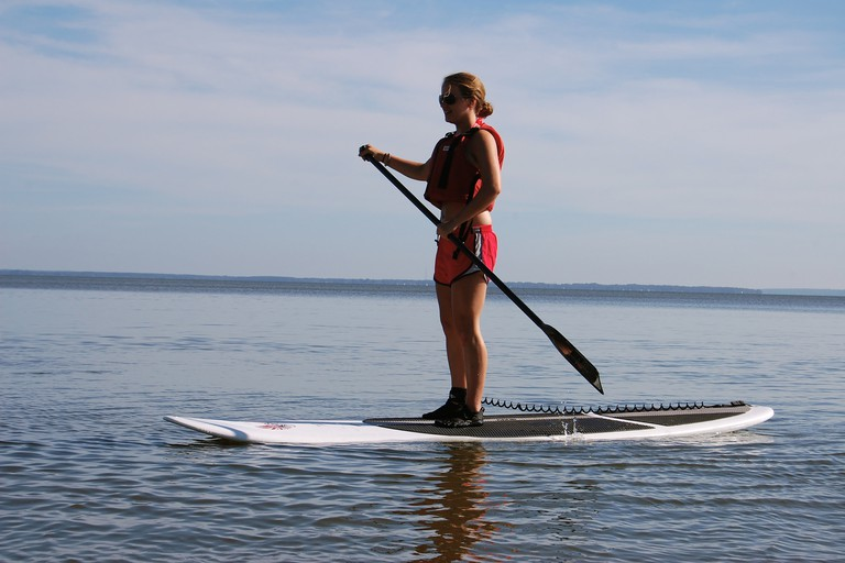 A confident paddleboarder enjoys the water