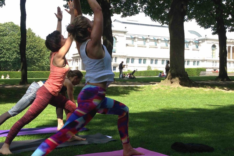 The Yoga Loft takes advantage of beautiful weather by moving classes into the green surroundings of the majestic Cinquantenaire Park