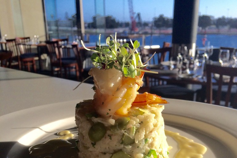 Mandurah blue manna crab and pea risotto with garlic prawns