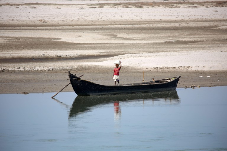 Sunsari, Nepal. 2nd Jan, 2020. A man prepares to ride a boat to cross Sapta Koshi river at Koshi Tappu Wildlife Reserve in Sunsari, Nepal, Jan. 2, 2020. Koshi Tappu Wildlife Reserve is popular for bird watching and observing the conservation of last remai