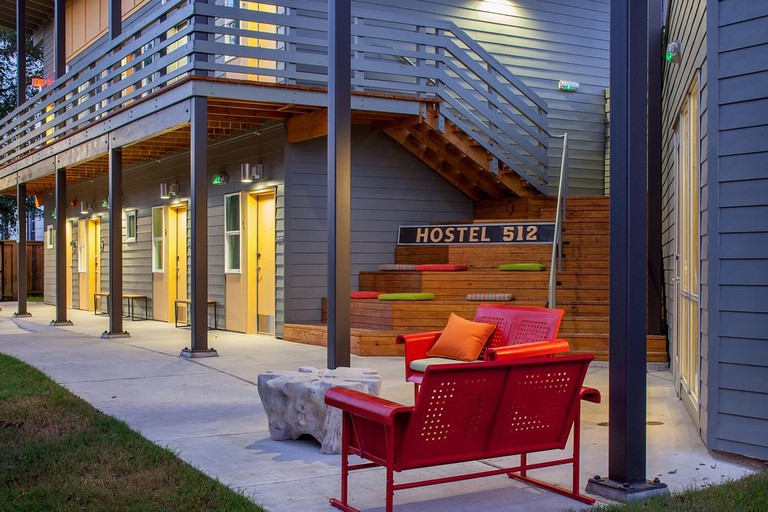 Hostel 512's yard features benches and chair swings