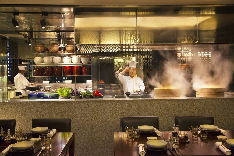 Chefs preparing food at the Chine Kitchen