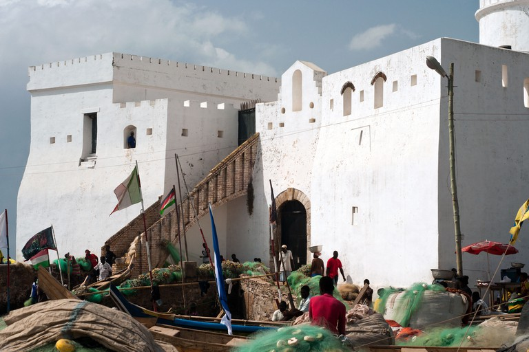 fishing boats and cape coast castle, cape coast, ghana, africa