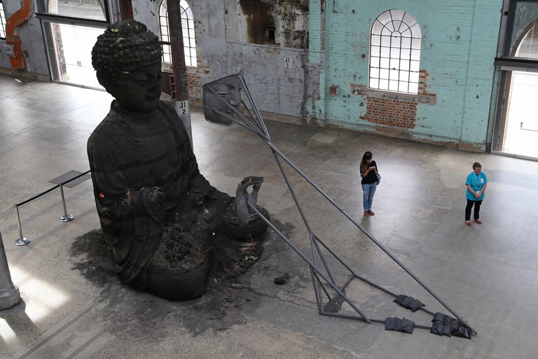 Sydney, Australia. 13 January 2015. Sydney Buddha consists of two parts facing one another. One is made of aluminium and the other from incense ash. It can be seen at the Carriageworks from 8 January to 15 March as part of the Sydney Festival. Credit: Cop