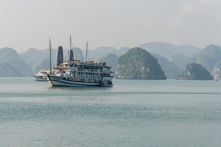 A tour boat sailing around Ha Long Bay