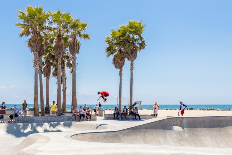 Skater boy practicing at the skate park at Venice Beach, Los Angeles, California. Venice Beach is one of most popular beaches of LA County