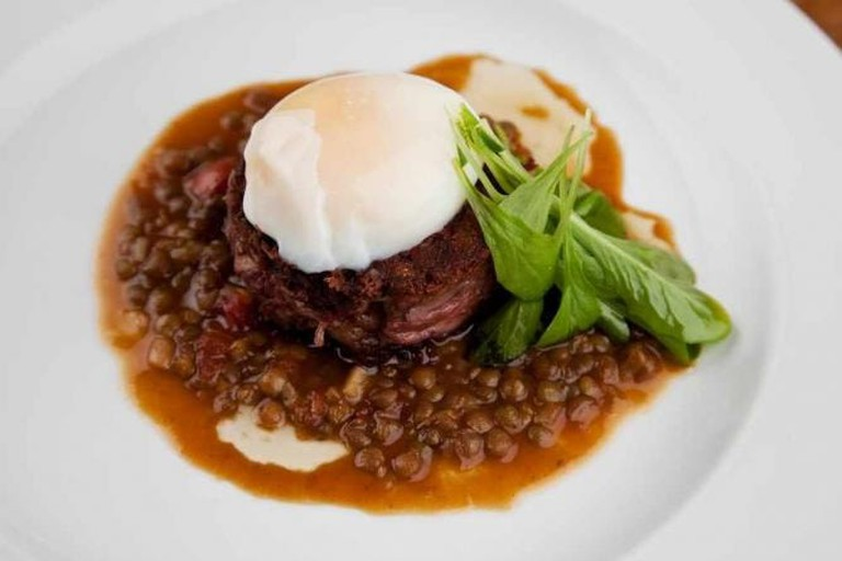 Iberian pig jowl with poached egg and braised lentils