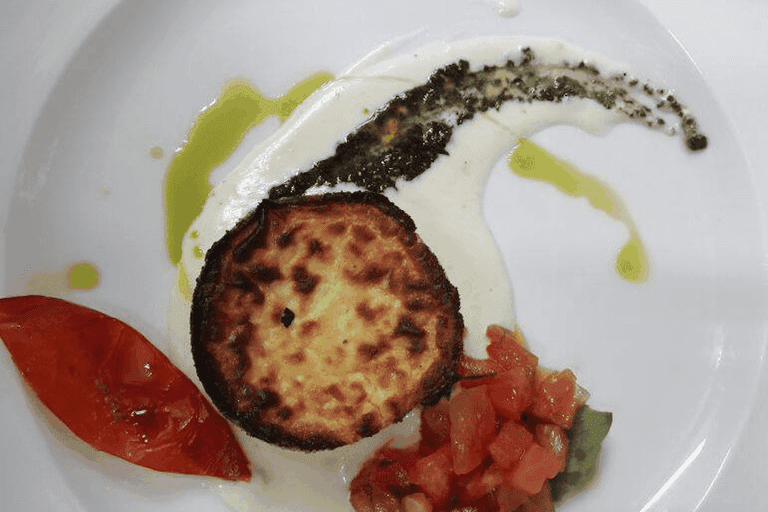 Melograno's parmigiano souffle with black truffles