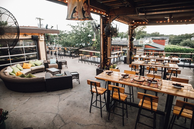 Sundown At Granada's rooftop patio is a popular spot in Lower Greenville for dinner, free films, or live shows