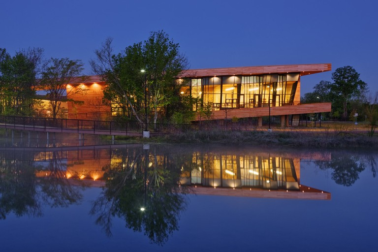 Trinity Audubon Nature Center lit up at night