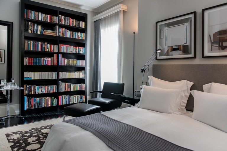 Bookshelves adorn every room at Hotel Montefiore