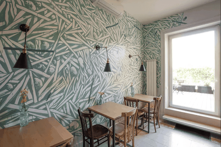 This Airbnb contains a mural painted by street artist Tellas