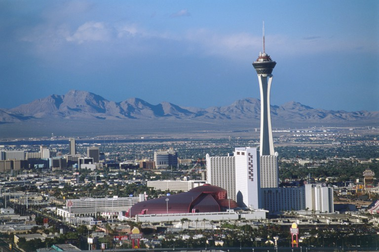 Cityscape with Stratosphere Tower and mountains in the background