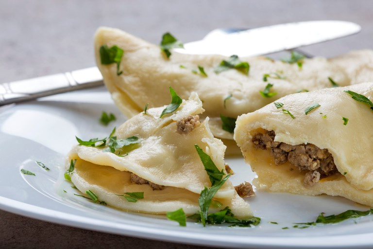 Pierogi, pyrohy or dumplings, filled with beef meat and covered with parsley.