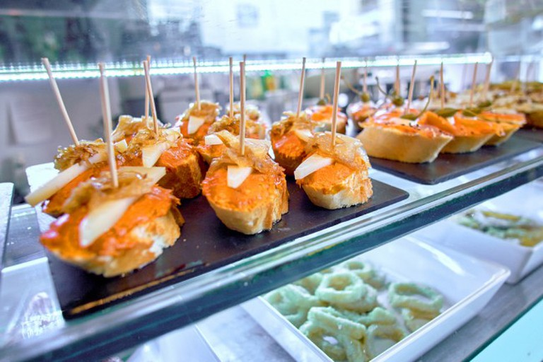 Spanish Tapas topped with red and white fish
