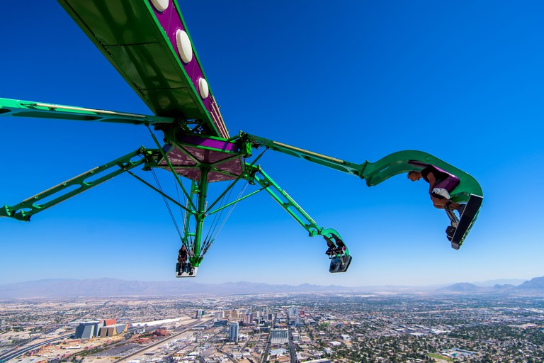 Insanity ride at top of the Stratosphere tower in Las Vegas Nevada. A massive mechanical arm extending out 64 feet over the edge of the Stratosphere Tower.