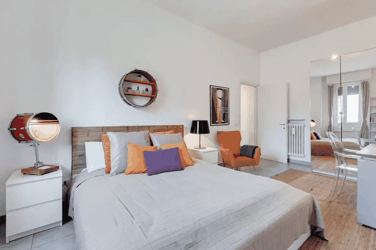 The bedroom includes furniture made from musical instruments