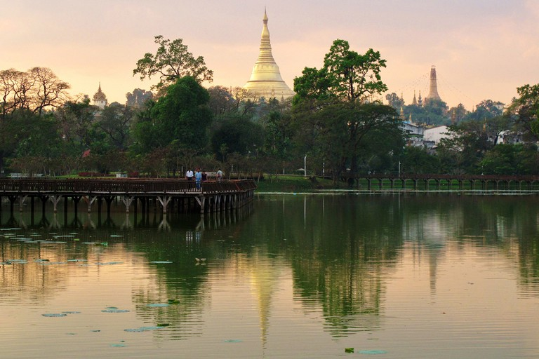 The Shwedagon Pagoda reflected on Kandawgyi Lake in Yangon, Myanmar