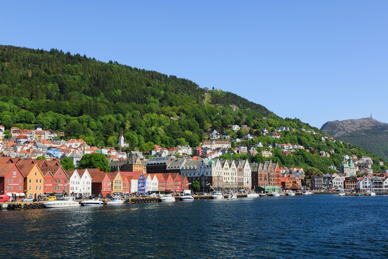 Medieval Hanseatic buildings on Bryggen wharf from Vagen harbour, Bergen, Hordaland, Norway.