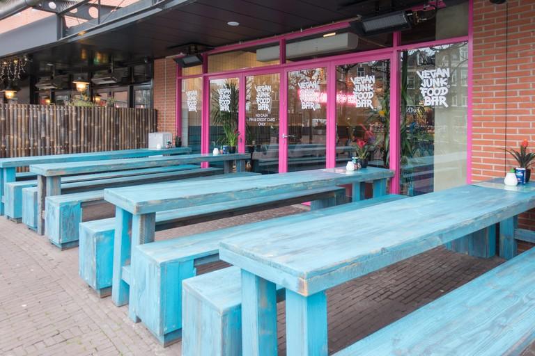 Exterior of Vegan Junk Food Bar on Marie Heineken Plein in Amsterdam, the Netherlands