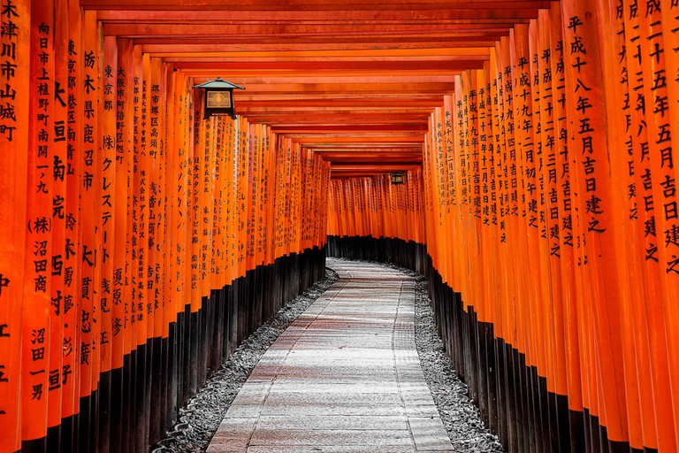 Walk through the red torii gates at Fushimi Inari-Taisha Shrine