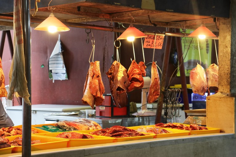 Typical butcher at a wet market in Johor Bahru, Malaysia