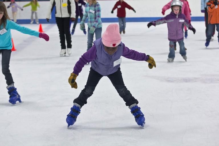 Child ice skating