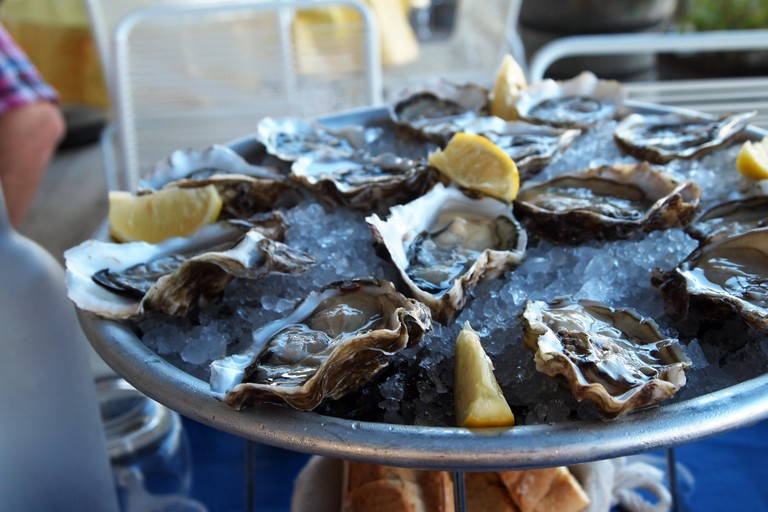 Oyster platter with ice and lemon