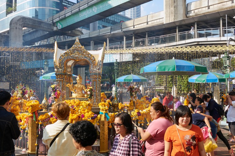 Lay down offerings at the Erawan Shrine
