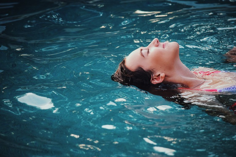 Girl floating in water