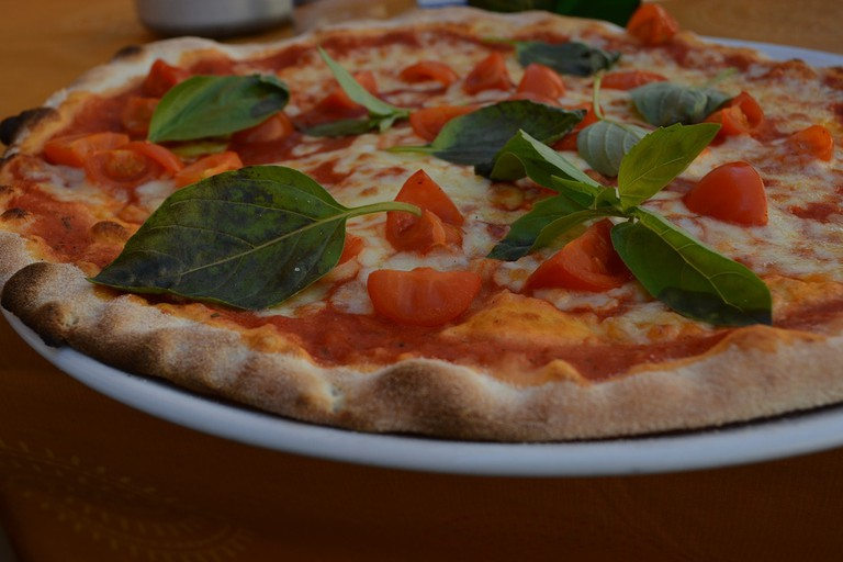 Enjoy some pizza with a cafe experience
